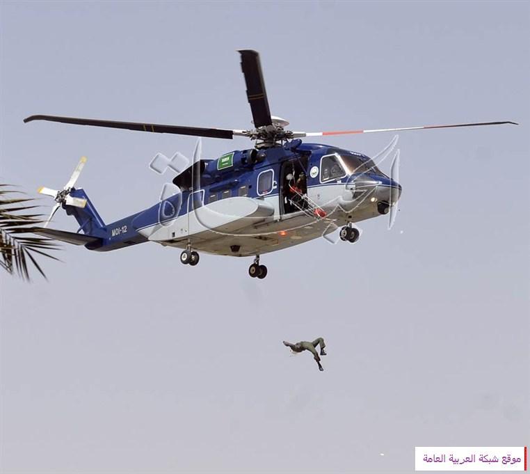 لحظات سقوط الجندي القحطاني من طائرة الأمن بالصور 13622347245.jpg