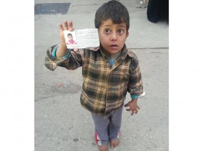 طفل سوري يزوّر بطاقة للحصول على ثياب الإغاثة 1387026718751.jpg