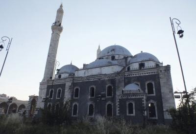 الشيعة يرفعون آذانهم على مسجد خالد بن الوليد في حمص 138900094751051.jpg