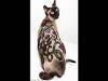 مسابقة دولية تحول القطط إلى أسود وكلاب 139731214651.png