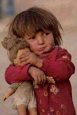 دمية طفلة فلسطينية 1406879663171.jpg